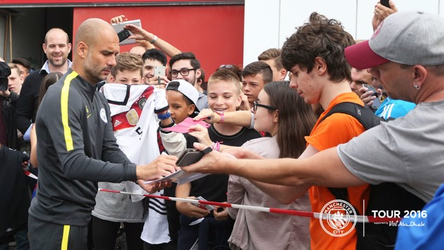 HERO: Pep Guardiola pens some autographs for fans
