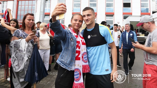 SELFIE MODE: Sinan Bytyqi grabs a snap with a supporter