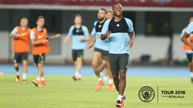 Shenzhen smile: Raheem's enjoying being back amongst the squad.