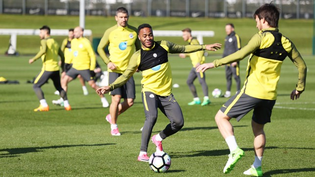 ATTACK, ATTACK: Raheem Sterling and David Silva battle for possession