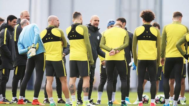 JOKE: Guardiola shares a joke with his players