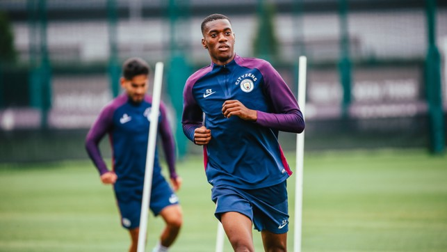 YOUNG GUN: Tosin stretches his legs.