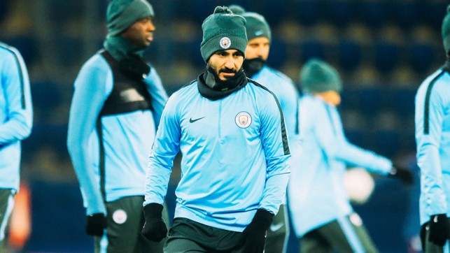 WRAPPED UP: Ilkay Gundogan was protected from the elements.