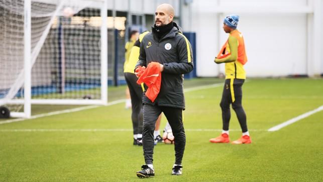 EL SENOR: Pep Guardiola gets the session under way