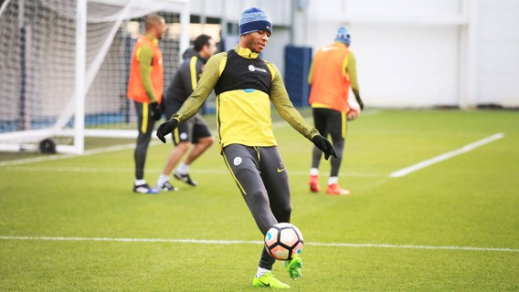 UNDER HIS SPELL: Raheem Sterling gets a touch of the ball as the session moves on