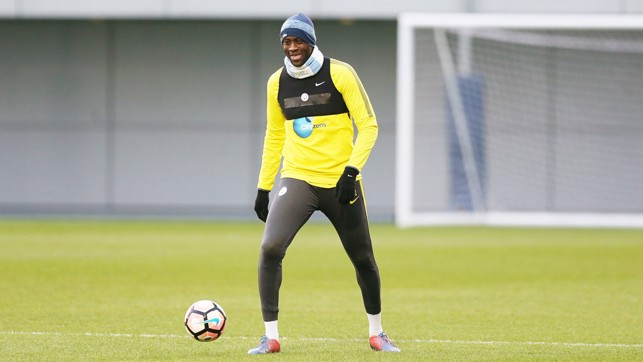 SHARING A JOKE: Yaya Toure is all smiles as City work the ball around