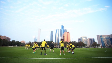 DOWN BELOW: Ground shot as the players stretch in Abu Dhabi.