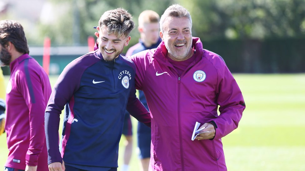SMILES: Patrick Roberts shares a joke with assistant coach Domenec Torrent