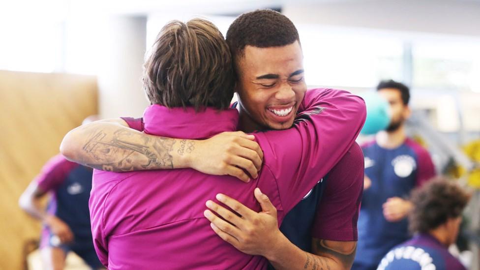 HUG: Gabriel Jesus and coach Lorenzo Buenaventura share a moment