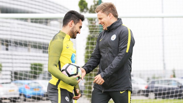 HELPING HAND: City's medical staff put Ilkay through his paces.