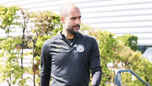 BOSS: Pep makes his way to the training pitch.