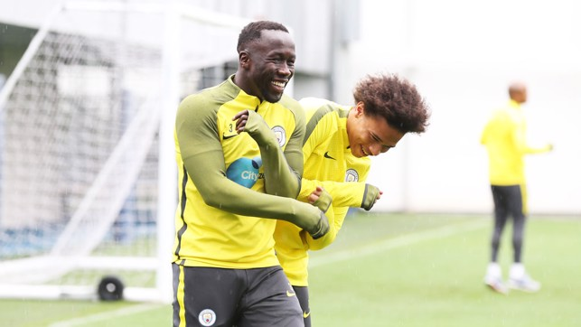 JOKES: Bacary Sagna and Leroy Sané joke around during practice.
