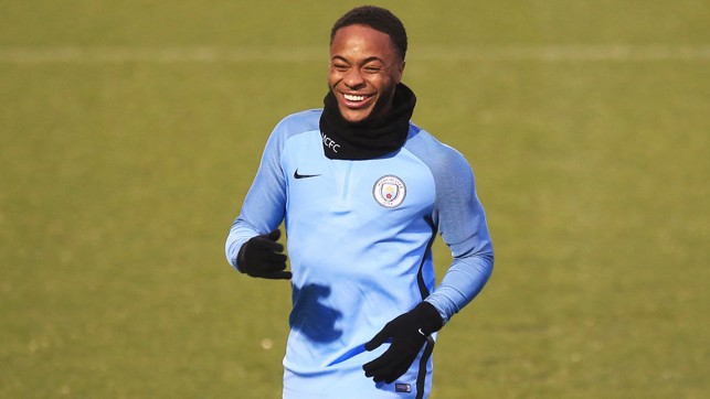 STERLING WORK: It isn't a training gallery without a shot of Raheem Sterling's grin!