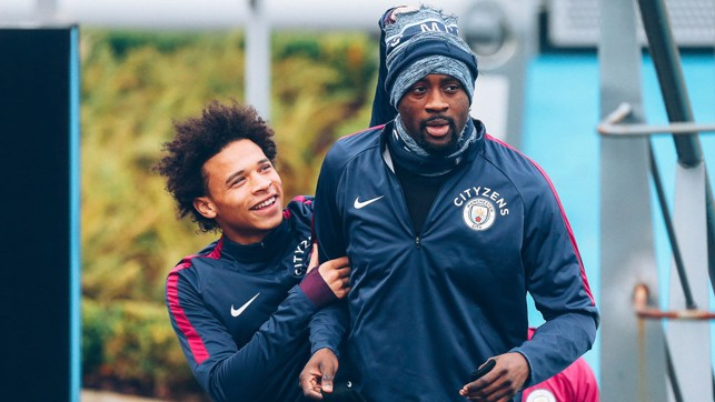ON YER HEAD: Leroy Sane attempts to dispossess 'Uncle Yaya' of his much-needed headwear!