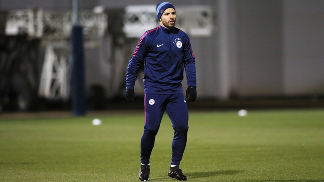 STANDING TALL: Aguero in action on a cold chilly night in Manchester