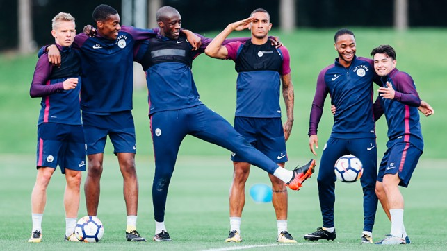BROTHERS IN ARMS: Team bonding and a salute from Danilo