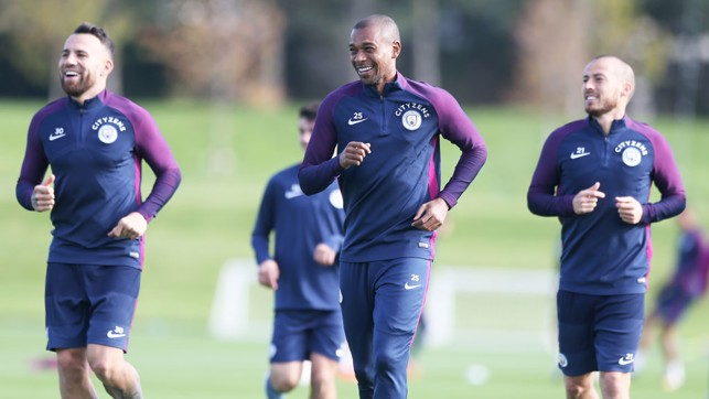 ALL SMILES: Nicolas Otamendi, Fernandinho and David Silva show off the pearly whites