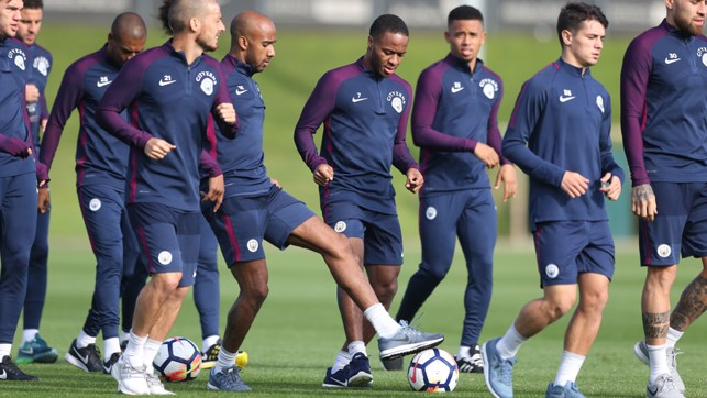 BALL WORK: Raheem Sterling looks to dispossess Fabian Delph