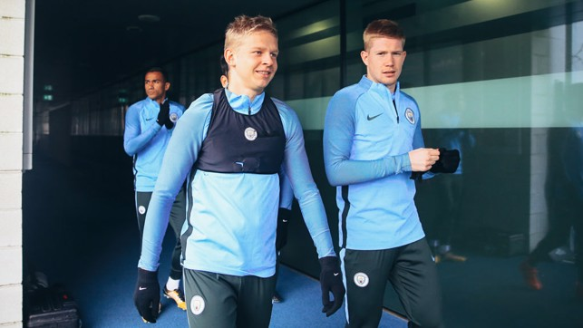 GLOVES ARE ON: Oleksandr Zinchenko heads out with Kevin De Bruyne