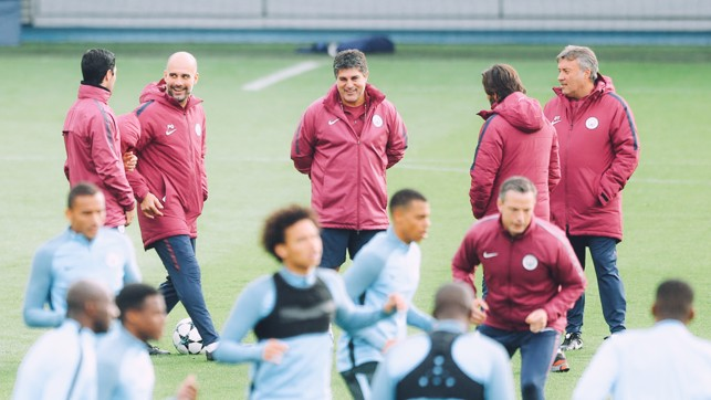 EYEING QUALIFICATION: Pep Guardiola (second left) in conversation with Mikel Arteta