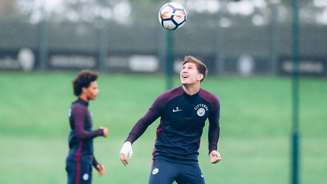 EYE ON THE BALL: John Stones isn't letting that ball out of sight!