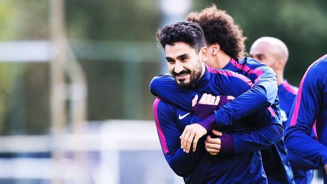 GOTCHA: Leroy Sane gives his compatriot Ilkay Gundogan a hug