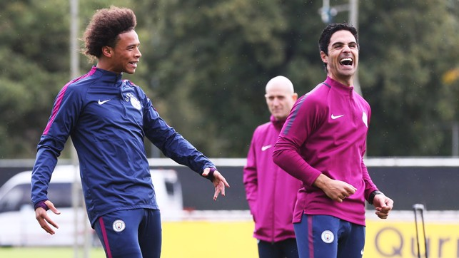 HAVING A LAUGH: Sane and coach Mikel Arteta