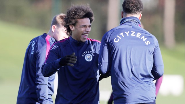 CHEEK TO CHEEK: Leroy Sane finds something very funny
