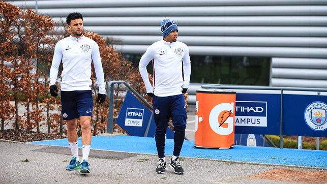 TWO BLUES: Kyle Walker and Gabriel Jesus step out onto the training pitches.