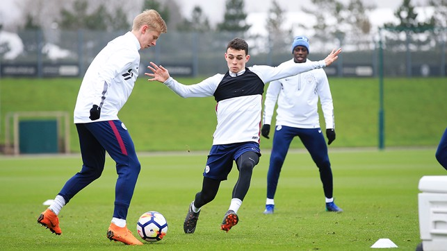 YOUNG GUN: Phil Foden goes head-to-head with Zinchenko.