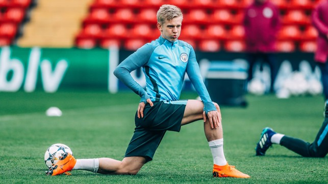STRETCH: Zinchenko warms up at Anfield.