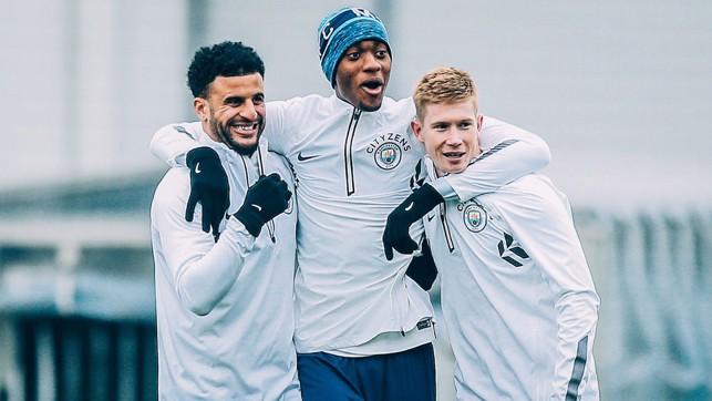 TRIO: Walker, Adarabioyo and De Bruyne team up in training.
