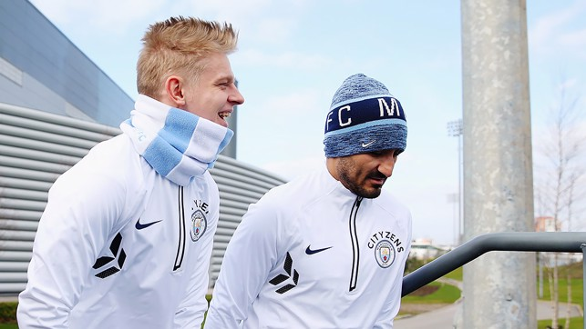 WRAPPED UP: Oleks and Ilkay had their winter warmers on.