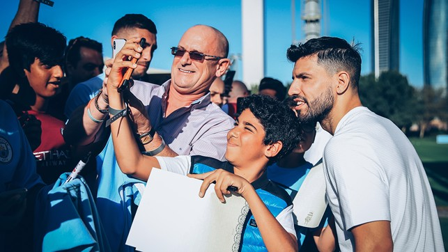 SELFIE: Sergio Aguero poses for a selfie with a young fan