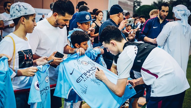 SHIRT SIGNING: Phil Foden signs a shirt in Abu Dhabi
