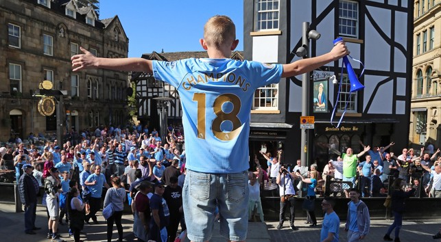 A young fans leads the singing....