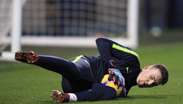 DOWN LOW: Cold work for keepers on a freezing Manchester evening
