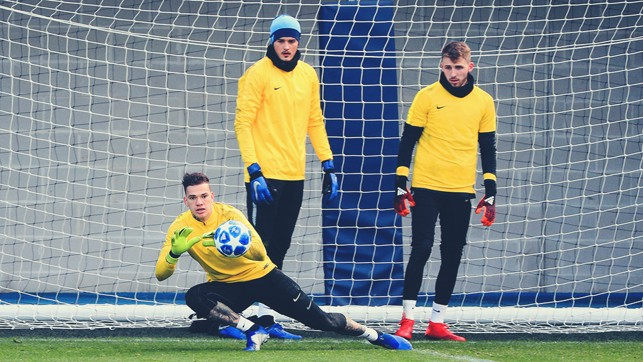 GOALKEEPERS' UNION: Ederson stoops to save