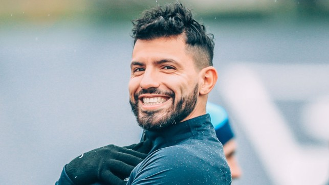 STRIKER POSE: Sergio Aguero smiles for the camera