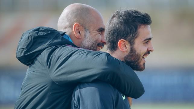 SMILES ALL ROUND: Pep Guardiola and Bernardo Silva share a laugh