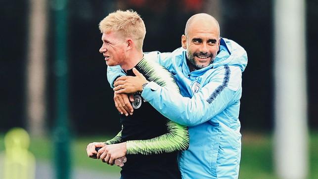 GIVE US A HUG: Pep Guardiola wraps his arms around Kevin De Bruyne