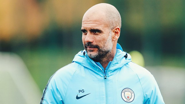 LEADING MAN: Pep Guardiola watches over the players as they go through their routines