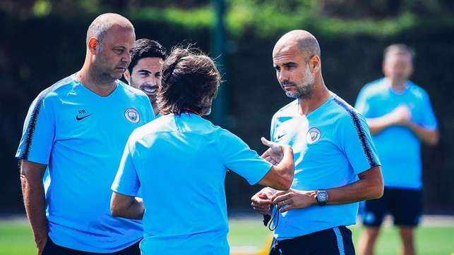 PEP TALK: The boss talks over pre-season training with members of the City coaching team