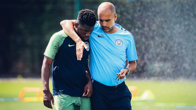 WORDS OF ADVICE: Pep Guardiola puts an arm around Tom Dele-Bashiru as he passes on some tips