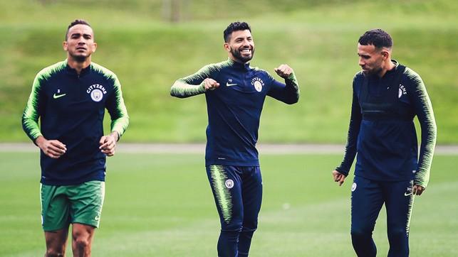 CENTRE OF ATTENTION: Sergio Aguero is all smiles alongside Danilo and Nicolas Otamendi