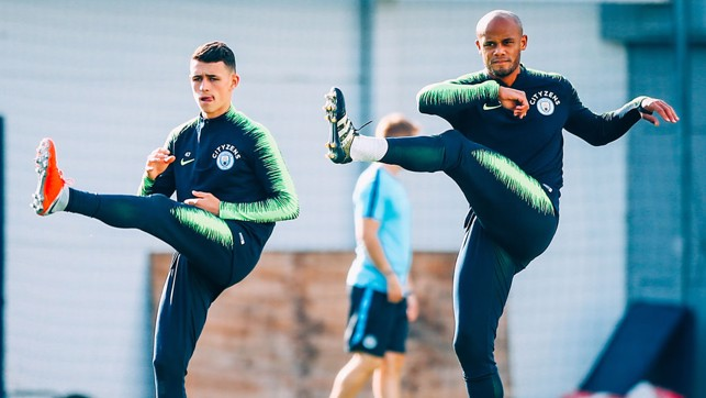 YOUTH AND EXPERIENCE:  Phil Foden and skipper Vincent Kompany warm up