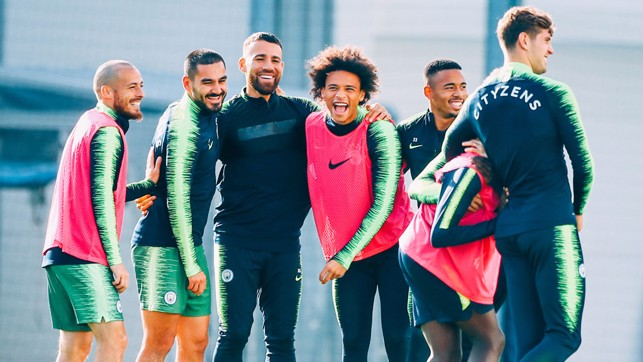 FEELING GOOD: The squad smile in the Manchester sun