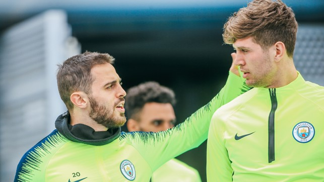 TWO BLUES, ONE STONES: Bernardo gives his teammate a pat on the back!