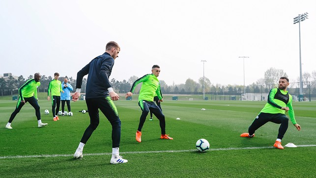 CLOSING IN: Phil Foden looks to intercept play