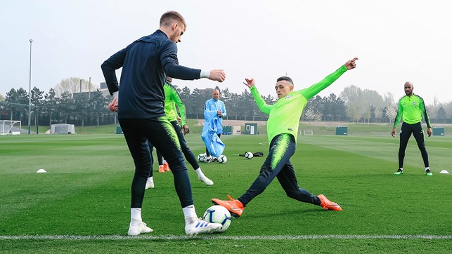 AT PHIL STRETCH: Phil Foden gets stuck in